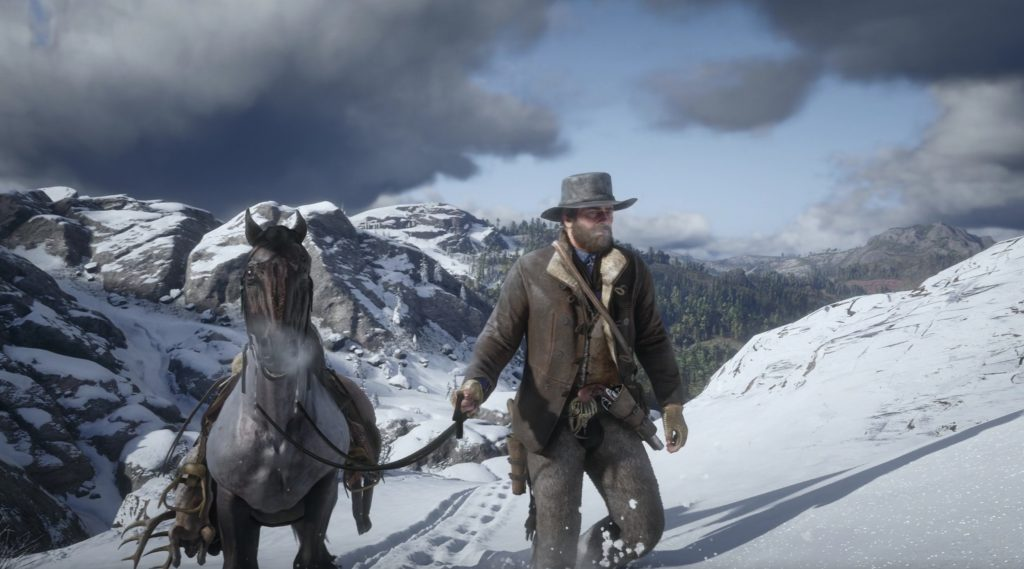 Arthur leads his horse through the snow