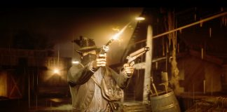 Arthur fires a pistol